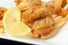 Fried Shrimp with Lemon stock photos