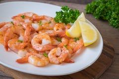 Fried shrimp with lemon on plate Stock Photos