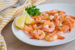 Fried shrimp with lemon on plate Royalty Free Stock Images