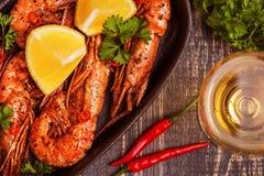 Fried shrimp with lemon and white wine royalty free stock photography
