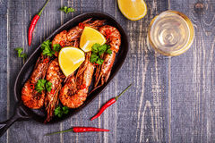 Fried shrimp with lemon and white wine Royalty Free Stock Image
