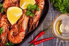 Fried shrimp with lemon and white wine Stock Photo