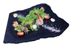 Fried shrimp with lettuce on a black stone Stock Image