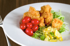 Fried Shrimp. A meal of fried shrimp and cherry tomatoes Royalty Free Stock Image