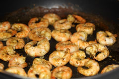 Fried shrimp in a pan Stock Photos