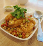 Fried Shrimp with paprika chili. On white plate and spoon Royalty Free Stock Images