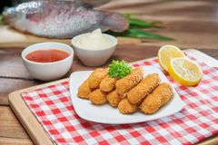 Fried shrimp paste on white plate with fresh fish, lemon and chi Stock Photos