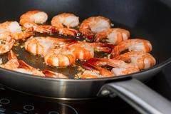 Fried shrimp in skillet Stock Image
