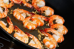 Fried shrimp in skillet cooking Stock Image