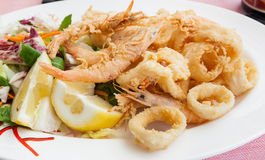Fried shrimp and squid with lemon. Stock Photos