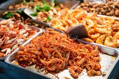 Fried shrimp in street food stall in Taiwan night market. Fried shrimp in street food stall in Asian night market stock photo