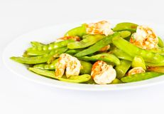 Fried shrimp and string bean. Fried shrimp and string bean on white dish Royalty Free Stock Images