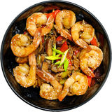 Fried shrimp with vegetables in a black plate, top view, white background. Fried shrimp with vegetables  in a black plate Stock Photos