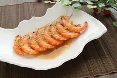 Fried shrimp on white plate stock images