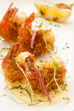 Fried shrimp wrapped in pastry threads Royalty Free Stock Photography
