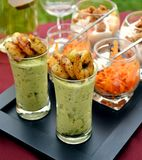 Fried shrimps with avocado in small jars Stock Photo