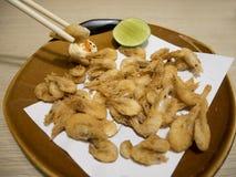 Fried shrimps with chopsticks. Stock Photos