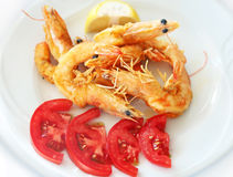 Fried shrimps with fresh tomatoes at a greek tavern Stock Photo