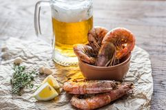 Fried shrimps with glass of beer Stock Photo