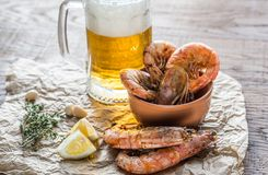 Fried shrimps with glass of beer Stock Image