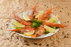 Fried shrimps with lemon on plate.  stock images