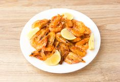 Fried shrimps with lemon. Royalty Free Stock Images