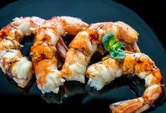 Fried shrimps with lemon wedges on the black background Stock Photo