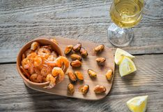 Fried shrimps and mussels with glass of white wine Royalty Free Stock Image