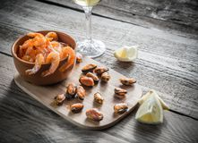 Fried shrimps and mussels with glass of white wine Stock Image
