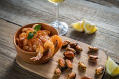 Fried shrimps and mussels with glass of white wine Royalty Free Stock Photography