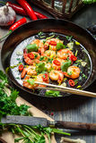 Fried shrimps on pan with fresh herbs Stock Images