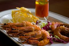 Fried shrimps on plate Stock Images