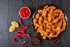Fried shrimps on a plate, flat lay stock images