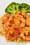 Fried shrimps with rice and broccoli. Fried shrimps with fried rice and broccoli on the side Stock Image