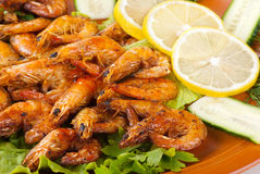 Fried Shrimps with Salad Leaves, Lemon Royalty Free Stock Image