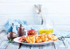 Fried shrimps. Fried shrims with tomato sauce and lemon stock photography