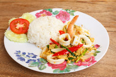 Fried Shrimps with Squid in Curry Powder Stock Photo
