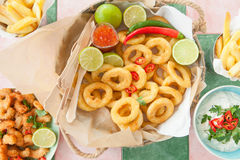 Fried shrimps and squid rings stock images