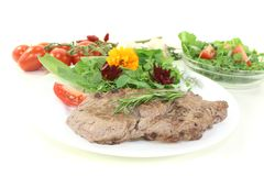 Fried Sirloin steak with wild herb salad Stock Photos