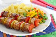 Fried skewers Stock Photos