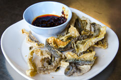 Fried skin fish with spicysauce. On table Royalty Free Stock Image