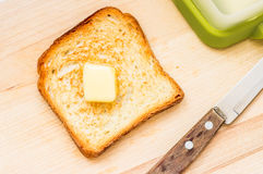 Fried slice of toast with butter. Top view Stock Photos