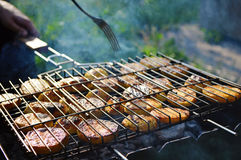 Fried sliced potatoes on the lattice-grill Stock Images