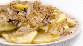 Fried sliced potatoes Stock Photo