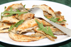 Fried smelts Baltic fish on a dish Royalty Free Stock Images