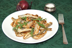 Fried smelts Baltic fish on a dish Royalty Free Stock Image