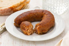 Fried smoked sausage on plate Royalty Free Stock Images