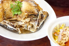 Fried snapper fish. Deep fried snapper fish with sweet fish souce and mango Royalty Free Stock Photo