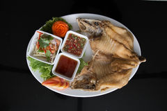 Fried snapper with fish sauce. And mango salad Royalty Free Stock Image