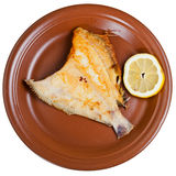 Fried sole fish on brown plate Stock Photo